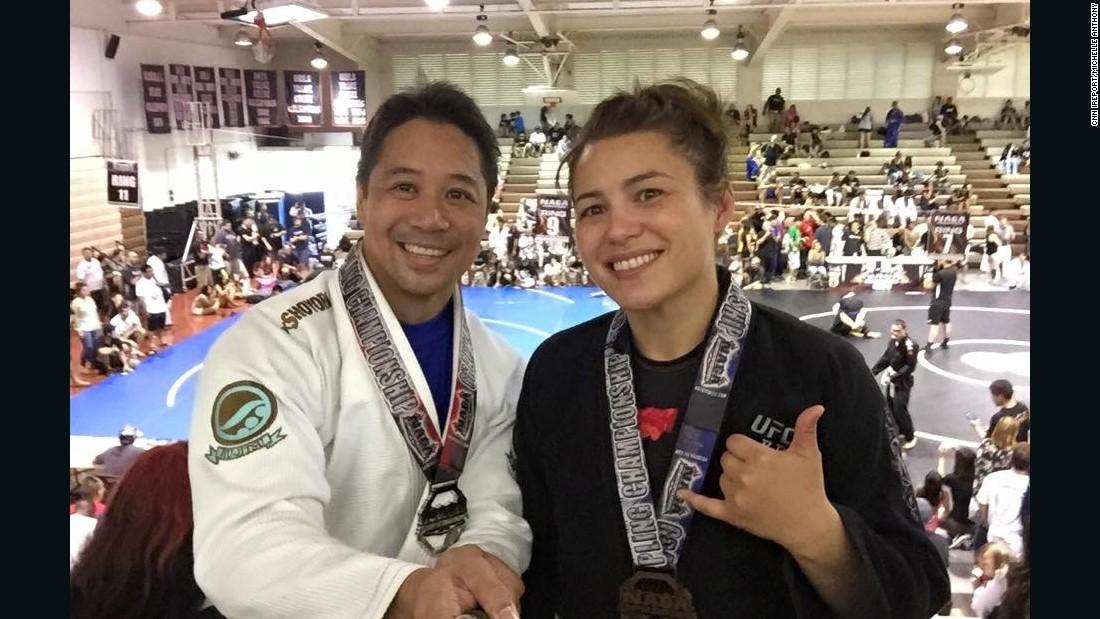Jiujitsu Bronze medalist Michelle Anthony (right) with her boyfriend. After years of crippling fear, she now feels confident because of her decision to take classes in jiujitsu.