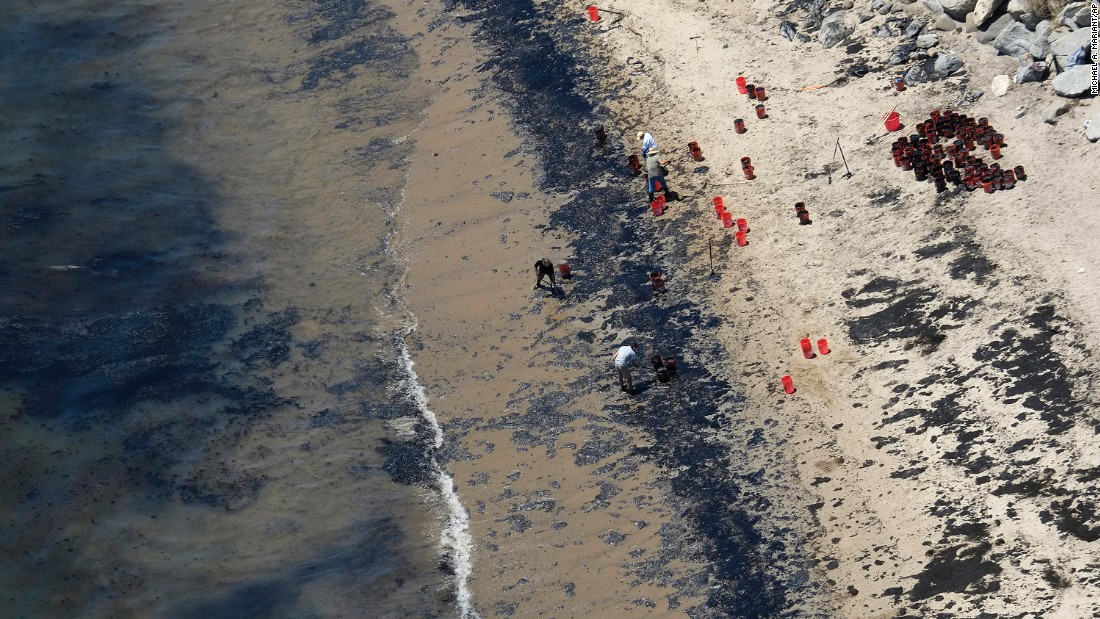 "Volunteers fill buckets with oil near Refugio State Beach after <a href=""http://www.cnn.com/2015/05/20/us/gallery/california-oil-spill/index.html"" target=""_blank"">an oil spill north of Goleta, California,</a> on Wednesday, May 20. More than 100,000 gallons of oil spilled from a ruptured pipeline along the Santa Barbara coast. The cause of the rupture is still under investigation."