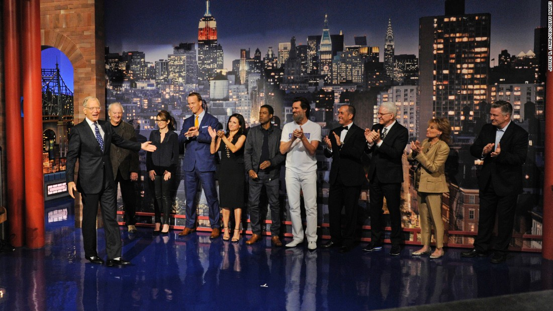 "Celebrities help retiring talk-show host David Letterman, left, present the Top 10 list Wednesday, May 20, <a href=""http://money.cnn.com/2015/05/20/media/david-letterman-goodbye-late-show/"" target=""_blank"">during his final ""Late Show"" episode.</a> Behind Letterman, from left to right, are Bill Murray, Tina Fey, Peyton Manning, Julia Louis-Dreyfus, Chris Rock, Jim Carrey, Jerry Seinfeld, Steve Martin, Barbara Walters and Alec Baldwin."