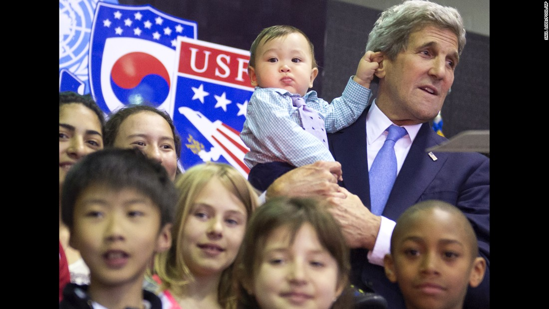 U.S. Secretary of State John Kerry holds 8-month-old Andrew Belz as he poses for photos with the children of U.S. troops and U.S. Embassy personnel in Seoul, South Korea, on Monday, May 18.