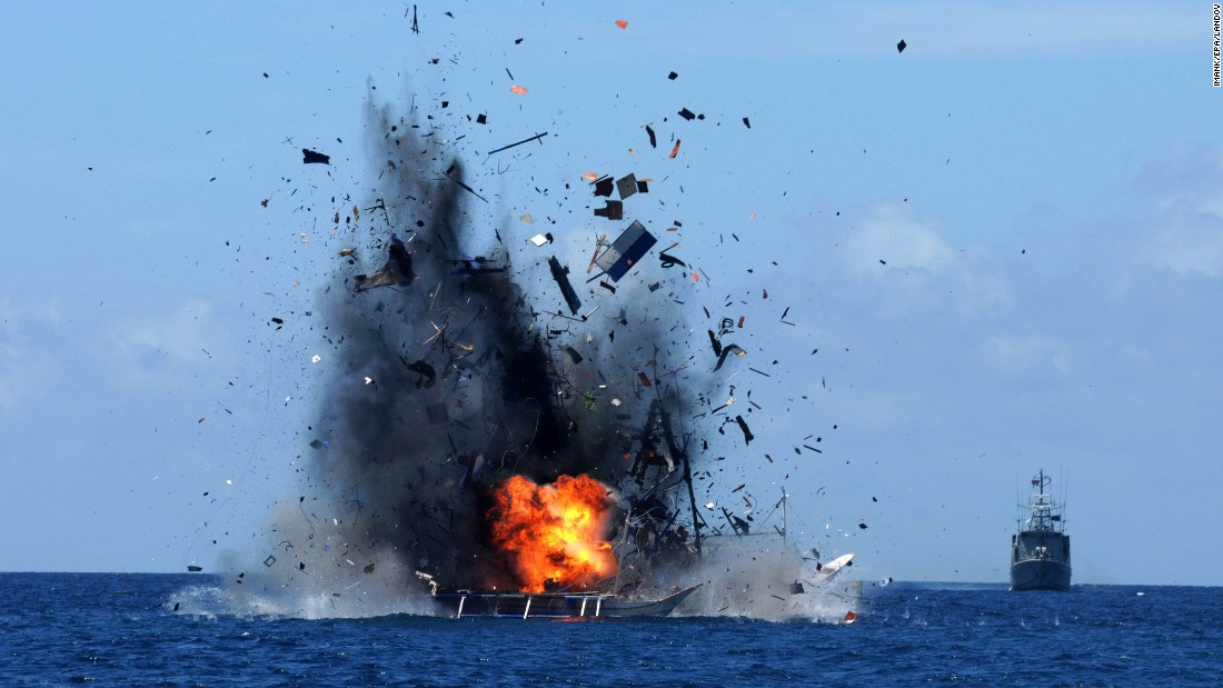 An Indonesian Navy ship blows up a foreign fishing vessel near Bitung, Indonesia, on Wednesday, May 20. According to media reports, Indonesia has sunk dozens of foreign boats across the country as part of an ongoing push to stop illegal fishing in its waters.