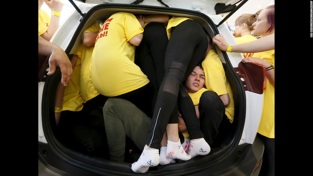 Students squeeze into a car in Krasnoyarsk, Russia, as they try to break a Guinness World Record on Saturday, May 16. Organizers of the event say they surpassed the record of 40 people.