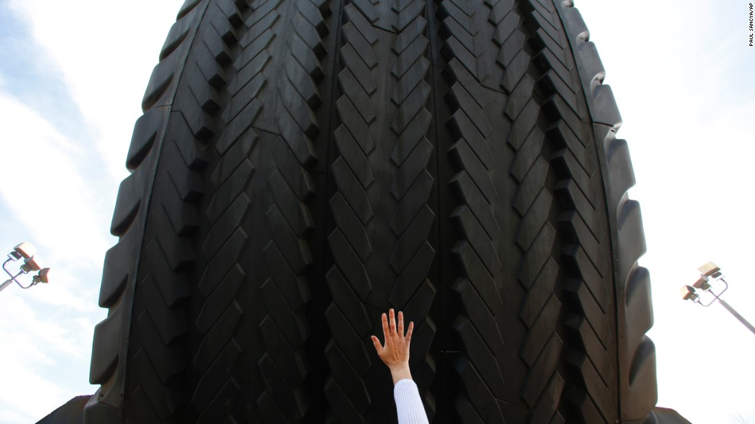 A visitor touches the Uniroyal Giant Tire in Allen Park, Michigan, on Wednesday, May 20. The 80-foot tire has stood alongside Interstate 94 since 1965, a year after it debuted at the New York World's Fair.