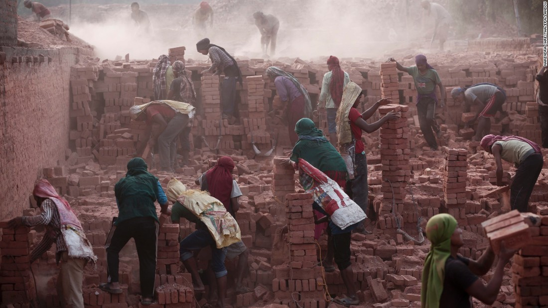 Laborers work at a brick factory in Bhaktapur, Nepal, on Tuesday, May 19. Nepal is facing an acute brick crisis after some 40 million houses -- and 80% of the country's brick kilns -- were damaged in two recent earthquakes.