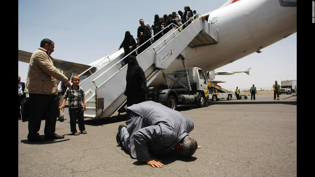 "A Yemeni man who was stranded in Egypt after <a href=""http://www.cnn.com/2015/01/20/world/gallery/yemen-unrest/index.html"" target=""_blank"">conflict broke out in his home country</a> prays and kisses the ground after arriving at the airport in Sanaa, Yemen, on Wednesday, May 20. A Saudi-led coalition has been carrying out airstrikes against Houthi rebels in Yemen since Yemen's President fled the country in late March."