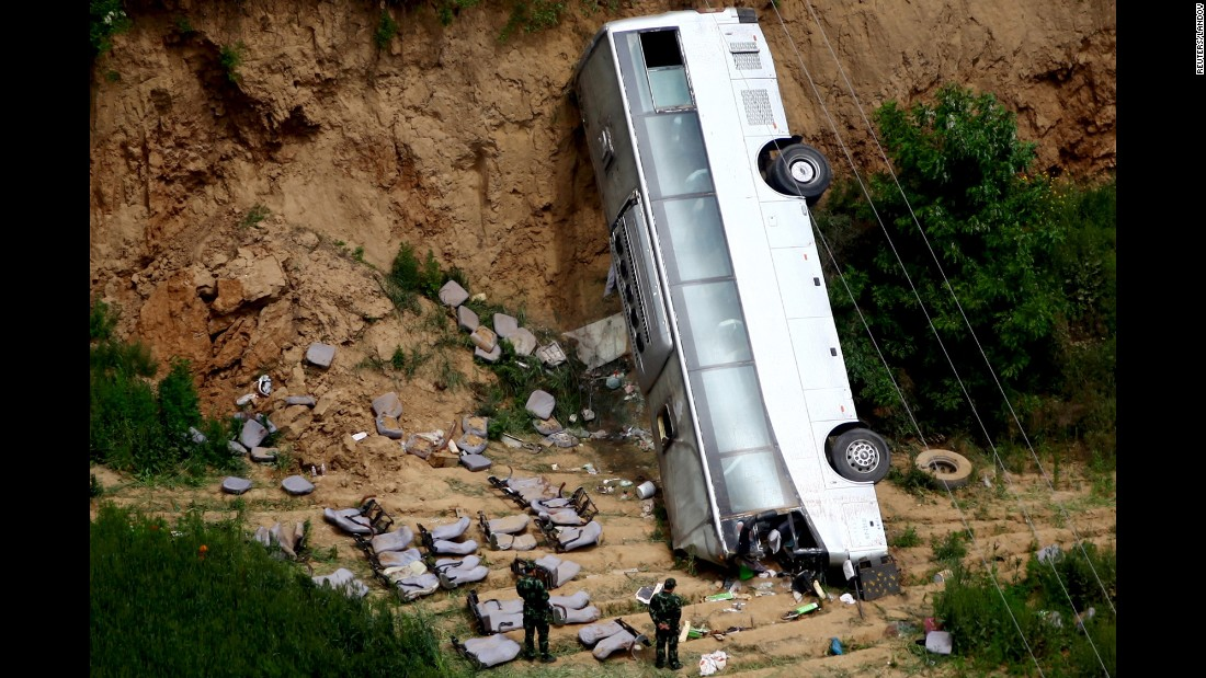 The remains of a bus are seen after a deadly crash in Xianyang, China, on Friday, May 15. At least 35 people were killed when the bus carrying 46 people plunged into a ravine, according to the Xinhua News Agency.