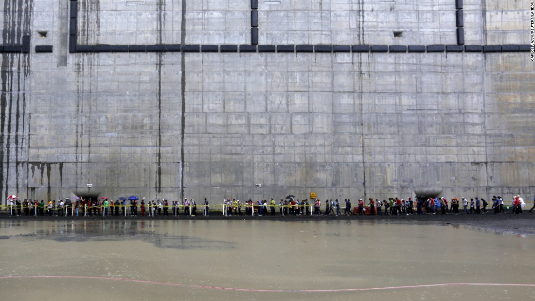 Visitors brave the rain during a tour of the new, expanded locks on the Pacific side of the Panama Canal on Sunday, May 17.