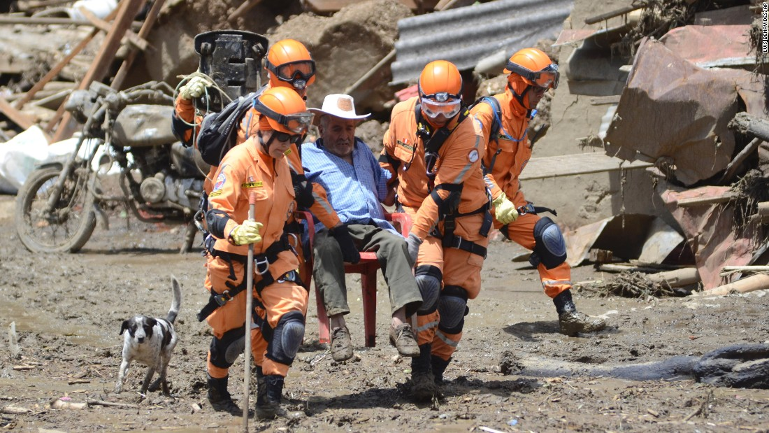 "Rescue workers help a man after <a href=""http://www.cnn.com/2015/05/19/world/gallery/colombia-landslide/index.html"" target=""_blank"">a deadly landslide in Salgar, Colombia,</a> on Tuesday, May 19. The landslide tore through a ravine one day earlier, killing more than 80 people, officials said."