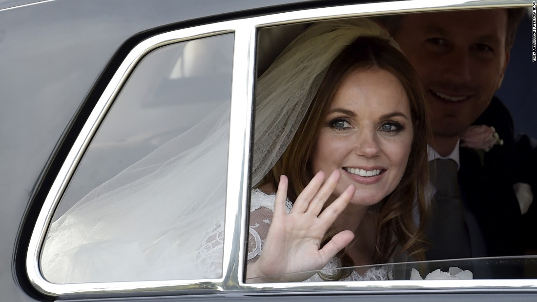 Singer Geri Halliwell, a former member of the Spice Girls, waves Friday, May 15, after marrying Christian Horner in Woburn, England. Horner is principal of the Red Bull Formula One racing team.