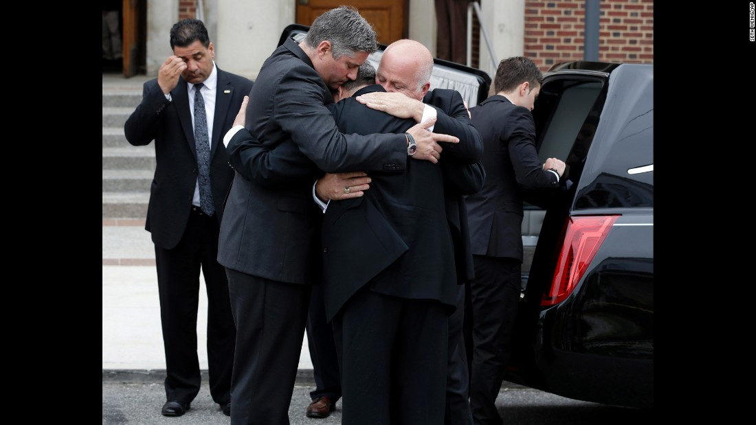 "Mourners in New York comfort one another Monday, May 18, during the funeral for Laura Finamore, one of the victims of <a href=""http://www.cnn.com/2015/05/13/homepage2/gallery/philadelphia-amtrak-crash/index.html"" target=""_blank"">the Amtrak train derailment</a> earlier this month. Eight people were killed and more than 200 were injured when the train derailed in Philadelphia."