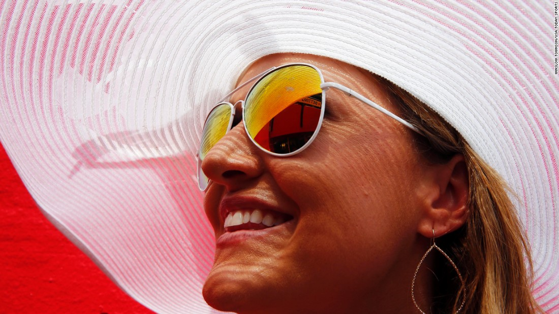 A woman waits for the start of the Preakness horse race Saturday, May 16, in Baltimore.