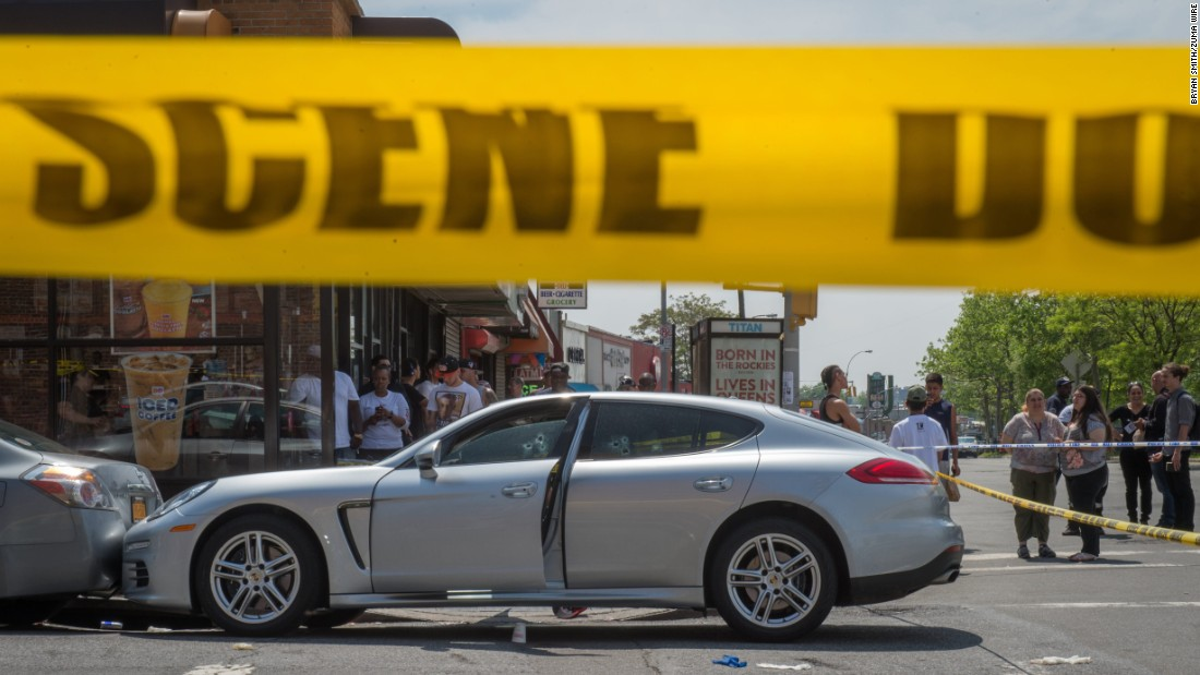 "People in New York gather at the scene where up-and-coming rapper Lionel Pickens, known by the stage name Chinx, <a href=""http://www.cnn.com/2015/05/17/entertainment/chinx-rapper-death-feat/"" target=""_blank"">was shot and killed</a> on Sunday, May 17."