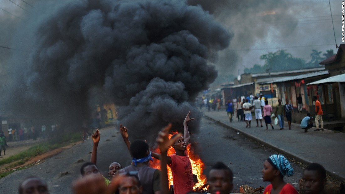 "Protesters gather by a burning barricade in Bujumbura, Burundi, on Tuesday, May 19. Animosity against President Pierre Nkurunziza <a href=""http://www.cnn.com/2015/05/14/world/gallery/burundi-unrest/index.html"" target=""_blank"">boiled over last month</a> when he expressed his intention to run for a third term."