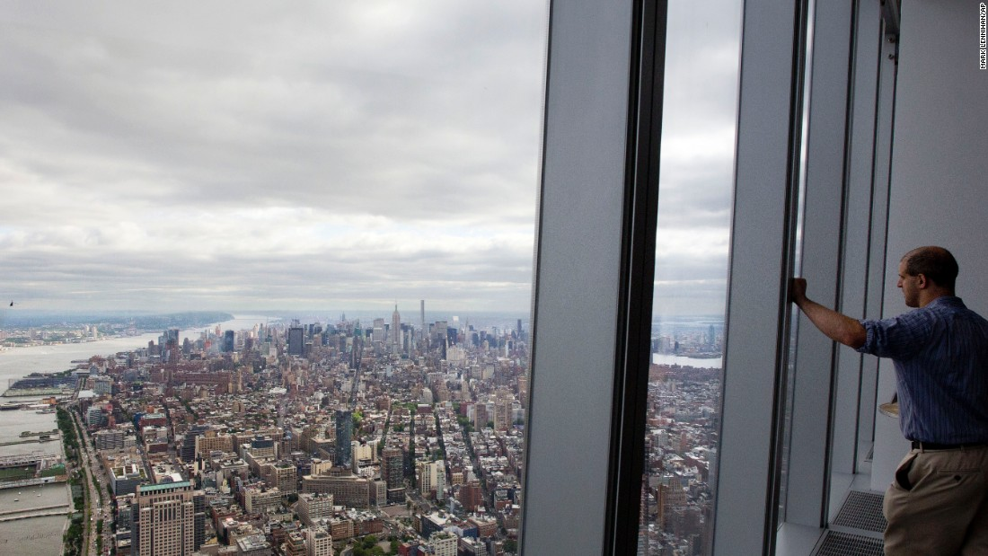 "A visitor at the One World Observatory looks over the New York borough of Manhattan on Wednesday, May 20. The observatory, atop the One World Trade Center, opens to the public on May 29. <a href=""http://www.cnn.com/2015/05/15/world/gallery/week-in-photos-0515/index.html"" target=""_blank"">See last week in 35 photos</a>"