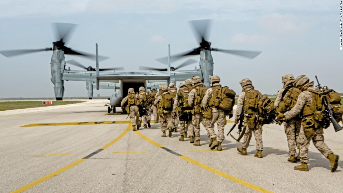 U.S. Marines with Special-Purpose Marine Air-Ground Task Force Crisis Response-Africa board an MV-22 Osprey during an alert force drill at Moron Air Base, Spain, on March 13, 2015. The alert force tested its capabilities by simulating a reaction to a real-time crisis response mission by flying to Sigonella, Italy, on a moment's notice.