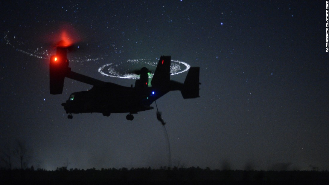 Combat controllers from the 21st Special Tactics Squadron fast-rope from a CV-22 Osprey during Emerald Warrior near Hurlburt Field, Florida, on April 21, 2015. Emerald Warrior is the Department of Defense's only irregular warfare exercise, allowing joint and combined partners to train together and prepare for real-world contingency operations.