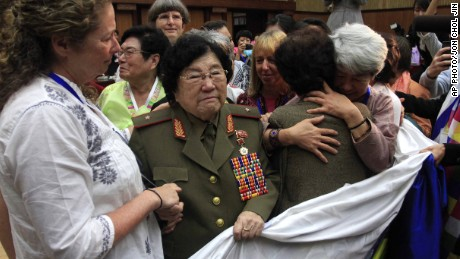 Documentary filmmaker Abigail Disney of the United States, left, shakes the hands of Jon Ku Gang, 68, second left, a North Korean woman who shared her experiences during the Korean War, at a meeting held at the People's Palace of Culture, Thursday, May 21, 2015, in Pyongyang, North Korea.