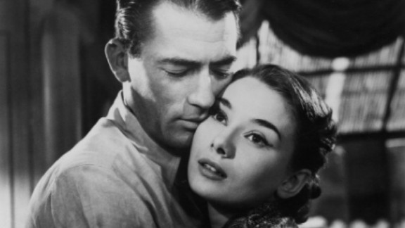 """""""Roman Holiday"""" (1953): Gregory Peck and  Audrey Hepburn star in this classic romantic comedy about a reporter and a princess. (Amazon)"""