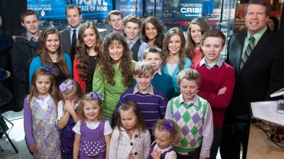 "The Duggar family, stars of the now-canceled TLC show ""19 Kids and Counting,"" visits ""Extra"" at its New York studios in March 2014."