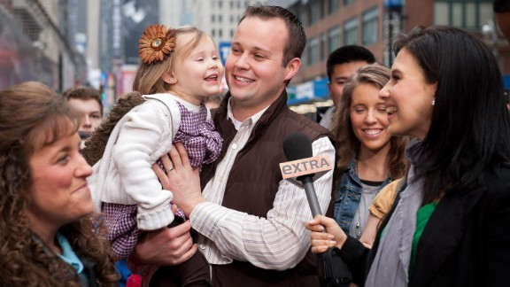 "Hilaria Baldwin (R) interviews Josh Duggar and his daughter during their visit with ""Extra"" in Times Square on March 11, 2013"