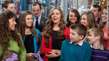 "he Duggar family visits ""Extra"" at their New York studios at H&M in Times Square on March 11, 2014 in New York City."