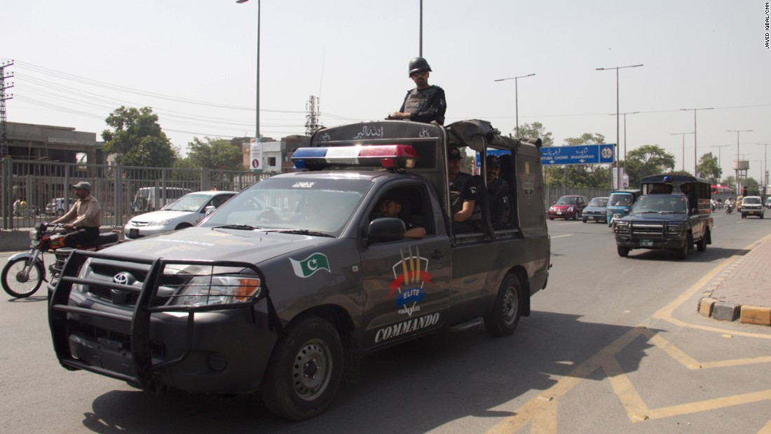 Police officials and paramilitary troops can be seen patrolling outside Gaddafi Stadium, where the attack on the Sri Lankan team took place in 2009.