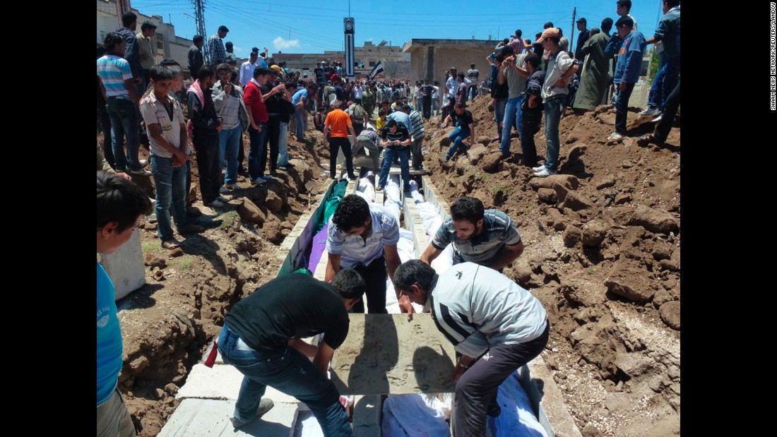 "People gather on May 26, 2012, at a mass burial for victims reportedly killed by Syrian forces in Syria's Houla region. U.N. officials confirmed that <a href=""http://www.cnn.com/2012/05/27/world/meast/syria-unrest/index.html"" target=""_blank"">more than 100 Syrian civilians were killed</a>, including nearly 50 children. Syria's government denied its troops were behind the bloodbath."