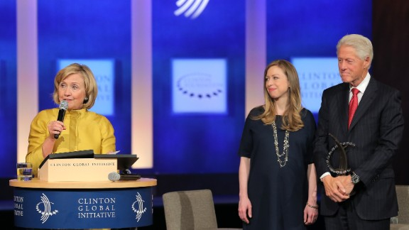 Former U.S. Secretary of State Hillary Clinton, vice-chair of the Clinton Global Initiative Chelsea Clinton and founder of the Clinton Global Initiative Bill Clinton onstage during the fourth day of the Clinton Global Initiative's 10th Annual Meeting at the Sheraton New York Hotel & Towers on September 24, 2014 in New York City.