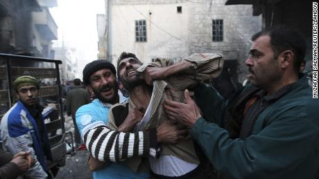 A father reacts after the death of two of his children whom activists said were killed by shelling from forces loyal to al-Assad in Aleppo on January 3, 2013.