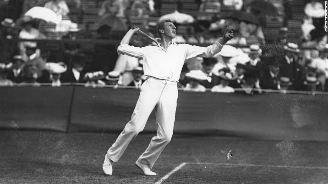 Tony Wilding of New Zealand serves during the 1908 Wimbledon Championships, played at the club's original Worple Road home.