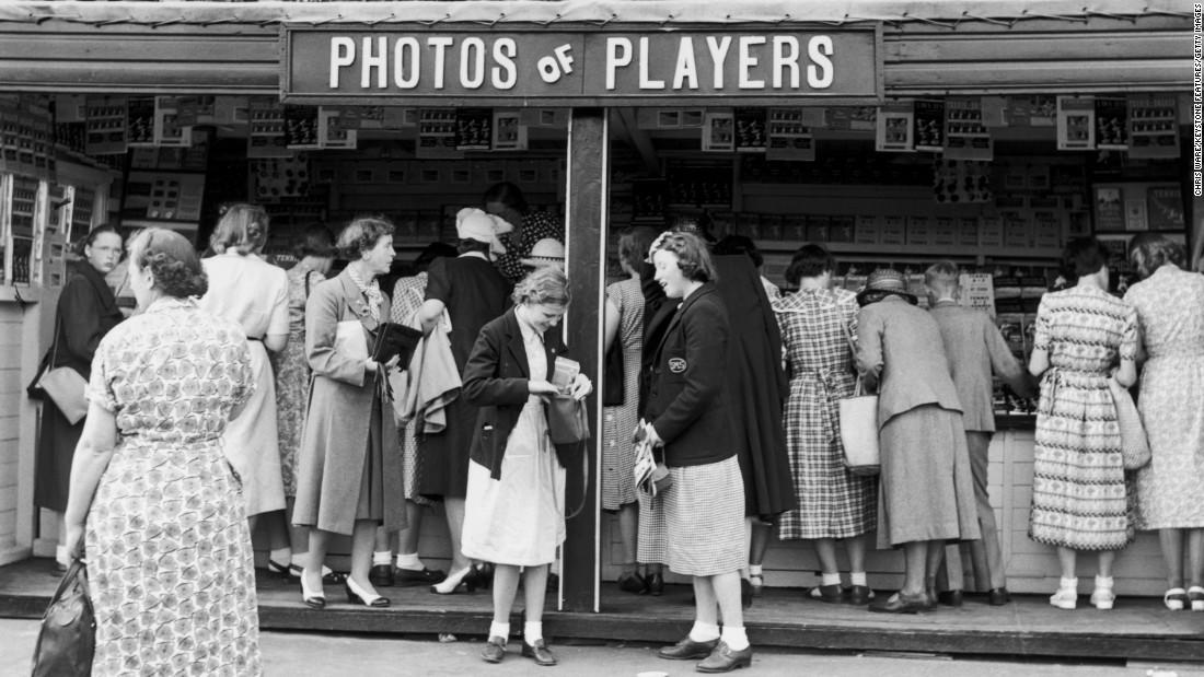 Fans buy photographs of their favorite players at a shop in the grounds of Wimbledon in 1951.