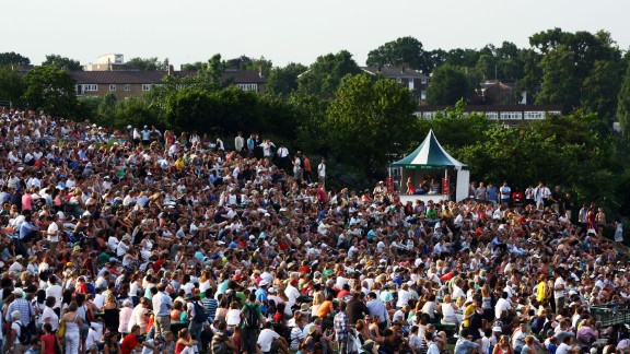 """Fans gather near giant screens on """"Murray Mount"""" as their hero takes on Stan Wawrinka of Switzerland in a fourth round match in 2009."""