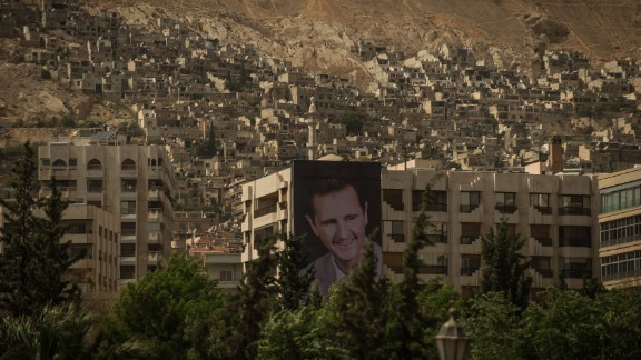 A giant poster of al-Assad is seen in Damascus on May 31, 2014, ahead of the country