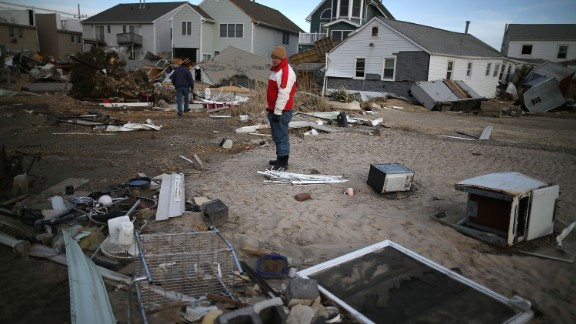 Sandy, 2012: It technically lost its hurricane status shortly before striking New Jersey, but its gigantic size -- it covered 1.8 million square miles at landfall -- sent devastating storm surges to the coast. Here, a man looks for pieces of his beach house after Sandy demolished it in Seaside Heights, New Jersey. With 72 directly killed in eight states, this was the most deadly tropical cyclone outside the South since 1972's Hurricane Agnes. At least 650,000 U.S. homes were damaged or destroyed in the U.S.