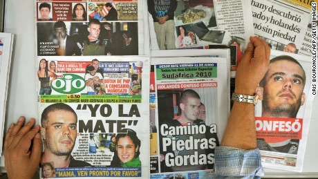 A man displays Peruvian newspapers with front pages allusive to the murder of 21-year-old Peruvian Stephany Flores by Dutch Joran Van der Sloot, on June 8, 2010 in Lima. Van der Sloot, 22, confessed having murdered  Flores last May 30, after which the Peruvian authorities are expected to conduct a reenactment of the murder tonight. The case brings up an earlier instance also in the disappearance of US citizen Natalee Holloway in Aruba on May 30, 2005 when Van der Sloot was acquitted for lack of proofs.