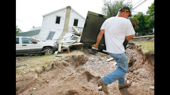 Irene, 2011: After hitting North Carolina, Irene did most of its damage in the way of heavy rain and flooding in New York and New England. In southern Vermont alone, nearly 2,400 roads were damaged or destroyed, NOAA says. Here, Tony Carr carries a TV set September 1 from his home, which was destroyed by Irene-related floods in Prattsville, New York.