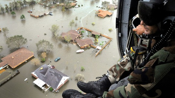 Ike, 2008: After killing scores in the Caribbean, Ike turned to Texas, sending storm surges that leveled homes on Galveston Island. It's remnants did extensive damage as far north as Ohio, where 2.6 million people lost power. Here, an Air Force Reserve pararescueman scans the ravaged Texas landscape shortly after Ike.