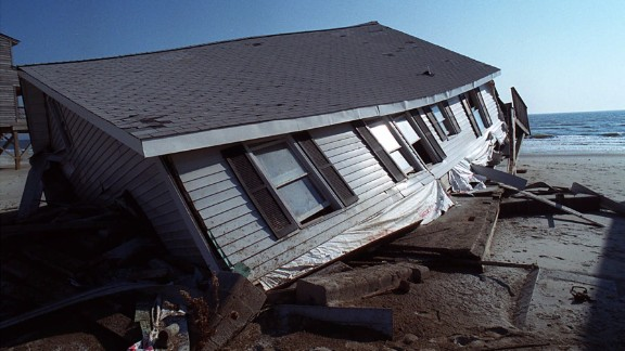 Floyd, 1999: Deadly flooding, especially in North Carolina, was one of Floyd's main legacies. Parts of eastern North Carolina and Virginia received 15 to 20 inches of rain, and flooding led to the razing of thousands of buildings -- most of them homes -- from North Carolina to New Jersey.  At the time, it was the deadliest U.S. hurricane since 1972. Here,a beach house, severely damaged by Floyd, sits crumbled sits in the sand on the Oak Island town of Long Beach, North Carolina, on November 10.