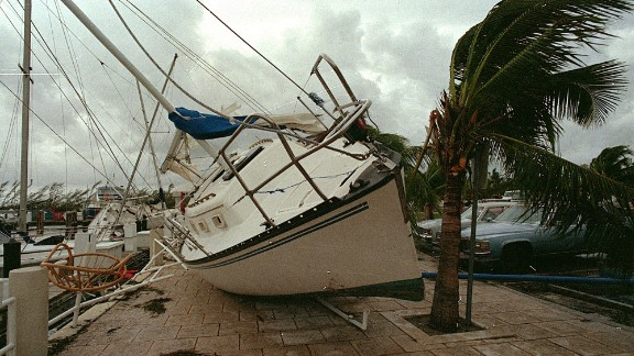 Andrew, 1992: Andrew blasted its way across south Florida on August 24 as a Category 4 with peak gusts measured at 164 mph. After raking entire neighborhoods in an around Homestead, it moved across the Gulf to hit Louisiana as a Category 3. It was responsible for 23 U.S. deaths and three in the Bahamas. Here, a sailboat sits on a sidewalk at Dinner Key in Miami after Andrew washed it ashore.