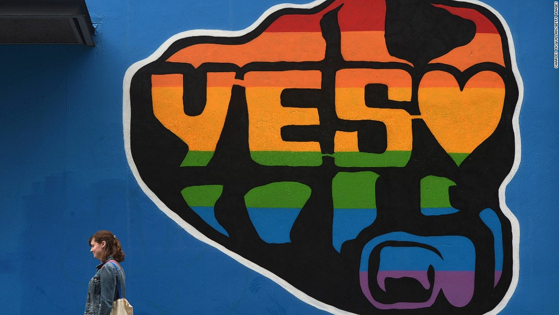 "A woman walks past a mural promoting the ""Yes"" campaign in favor of same-sex marriage on May 22 in Dublin, Ireland."