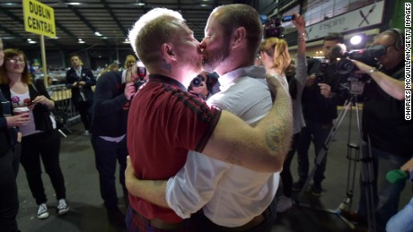 Gay couple Michael Barron and Jamie Nanci kiss during the referendum vote on same-sex marriage in 2015.