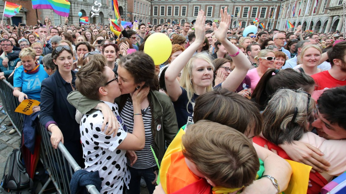 Supporters celebrate outside Dublin Castle following the announcement of the result of the same-sex marriage referendum.