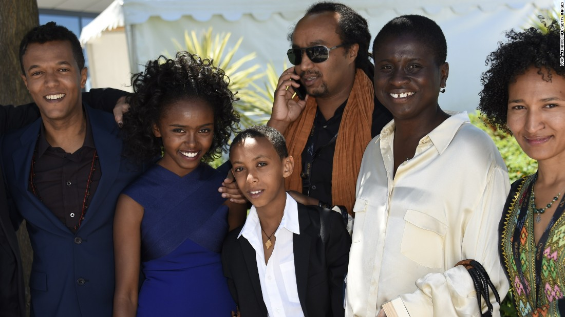 "Ethiopian director Yared Zeleke,actors Kidist Siyum and  Rediat Amare and producer Ama Ampadu (second right), pose with cast members from the film ""Lamb"" -- Ethiopia's first ever entry into the Cannes competition."