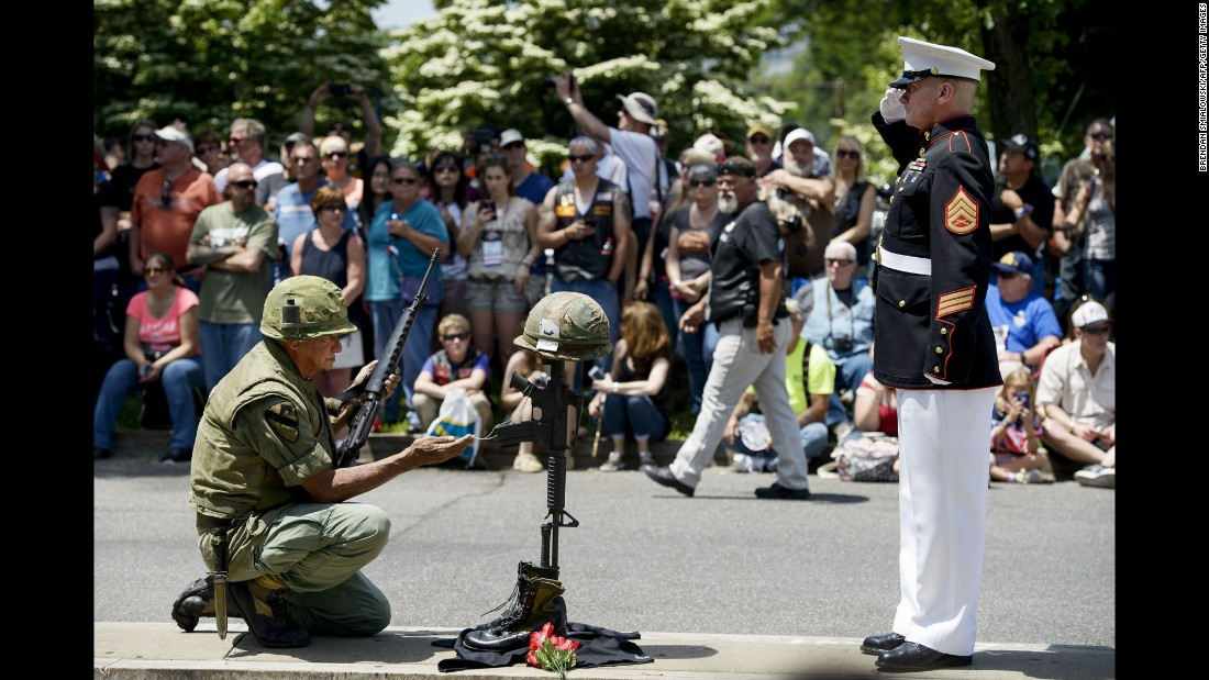 A Marine salutes a makeshift memorial during Rolling Thunder in Washington.