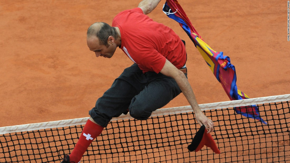 The spectator, wearing Swiss regalia, leaped the net to get near Federer in that final.