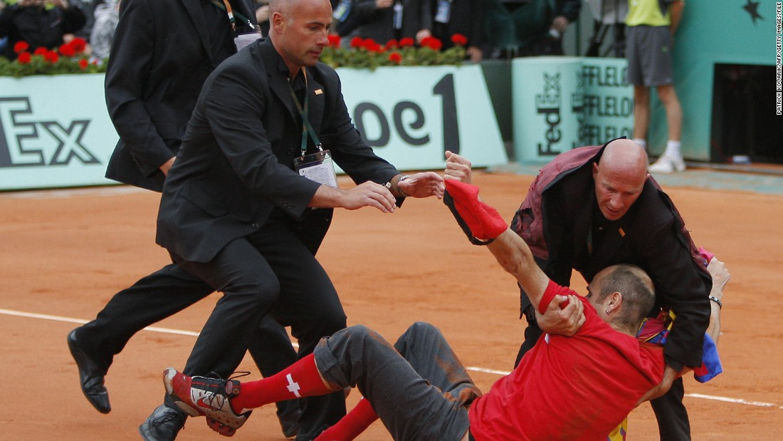 He was finally caught by security staff and Federer went on to beat Soderling for his first -- and only -- grand slam success on clay.