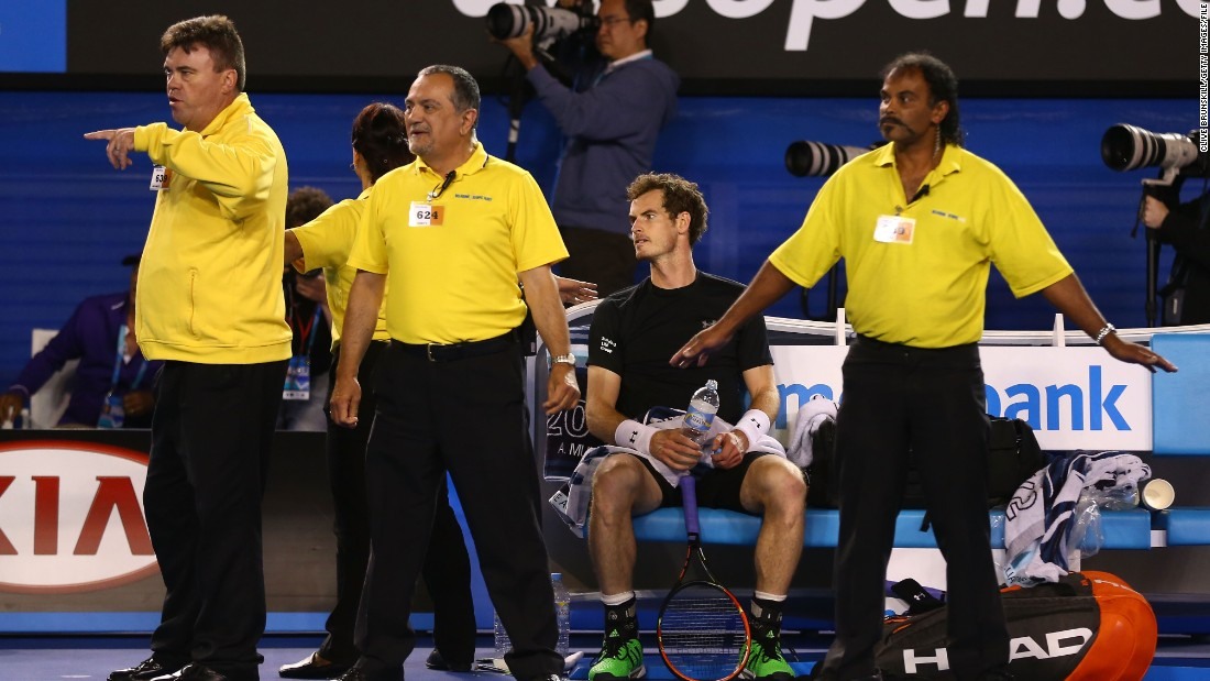 The 2015 Australian Open men's final was held up for several minutes by protesters. Here security staff surround Andy Murray, who was beaten in the final by Novak Djokovic.