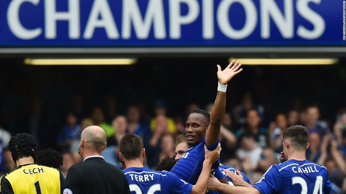Chelsea striker Didier Drogba waves goodbye to fans as he is carried off by teammates during the 3-1 win over Sunderland on the final day of the English Premier League season.