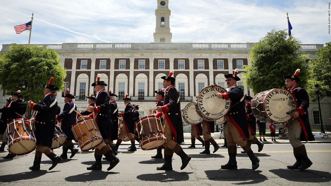 Marchers play drums during the Memorial Day Parade in Waterbury on May 24.
