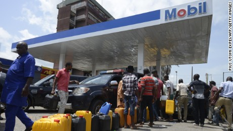 People line up to buy fuel last week at Mobil gas station in Lagos, Nigeria.